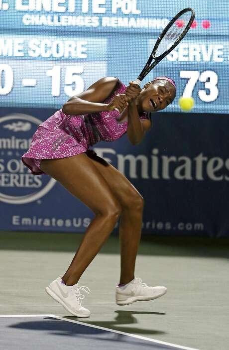 Venus Williams returns a shot against Magda Linette in 3rd set during Bank of the West Classic in Stanford, Calif., on Wednesday, July 20, 2016. Photo: Scott Strazzante, The Chronicle