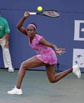 Venus Williams returns a shot in 1st set against Magda Linette during Bank of the West Classic in Stanford, Calif., on Wednesday, July 20, 2016.