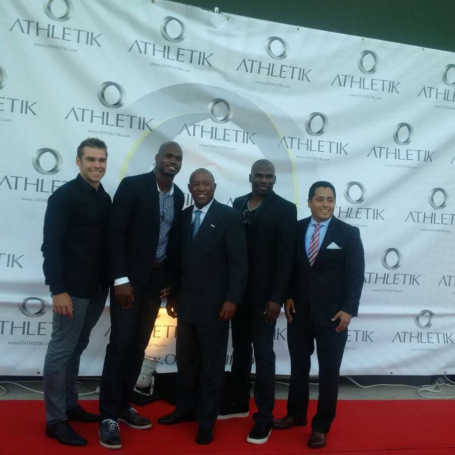 Minnesota Vikings running back Adrian Peterson and Houston Mayor Sylvester Turner at a red carpet event at O Athletik on Wednesday night. Photo: Aaron Wilson
