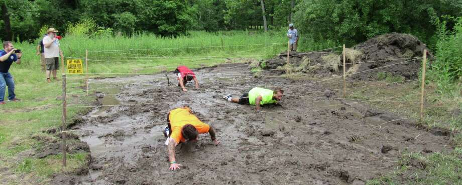 Harrybrooke Park in New Milford recently held the first Harrybrooke Hog Wild Hustle 5k trail run and obstacle course. The race included obstacles like a stump jump, balance beams and a sloppy mud pit. Photo: Courtesy Of Harrybrooke Park / The News-Times Contributed