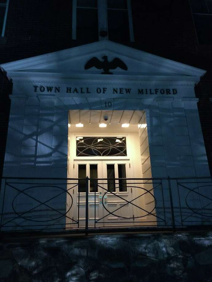 New Milford's Town Hall has been lit blue every night since July 18, 2016 as a show of support for police officers. Photo: Contributed Photo