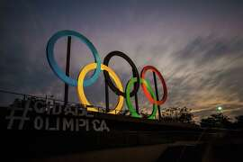 RIO DE JANEIRO, BRAZIL - JULY 19:  (EDITOR'S NOTE: Photo taken with a long exposure) View of the Olympic rings placed at Madureira Park, on July 19, 2016 in Rio de Janeiro, Brazil. The Rio Olympic Games run from August 5-21.  (Photo by Buda Mendes/Getty Images)