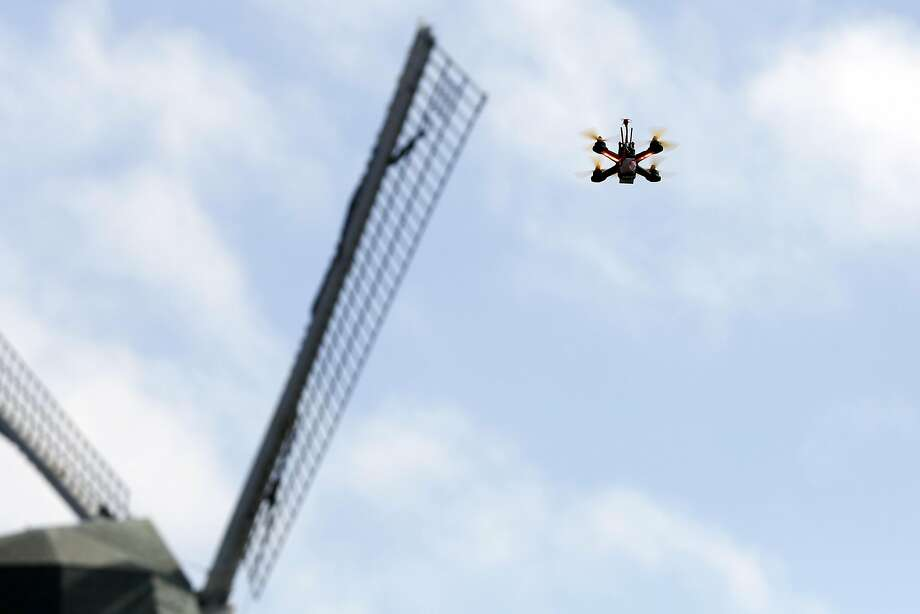 A racing drone flies near the Murphy Windmill at Golden Gate Park in San Francisco. While recreational drones are used in the city, San Francisco is only now developing draft rules for city agencies to use them. Photo: Connor Radnovich, The Chronicle