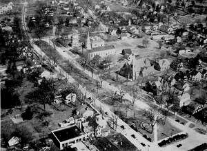 The Village Green in New Milford is a happening place. It flourishes with retail shops, restaurants, a variety of general businesses, several places of worship, an arts center and more. This aerial view of downtown circa mid-1930s depicts some of the buildings that house many of today's businesses and organizations.