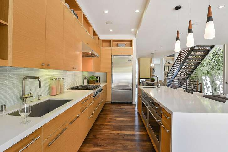Viking appliances and Caesarstone counters accent the chef's kitchen.