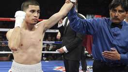 Adam Lopez (left) celebrates after his bantamweight fight with Richard Hernandez on Feb. 4, 2012 at the Alamodome.