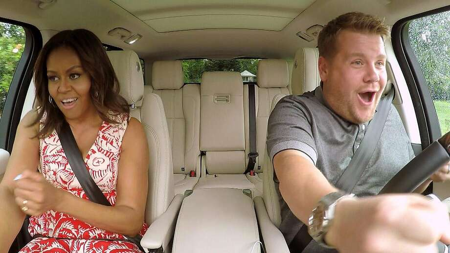 """In this undated image released by CBS, first lady Michelle Obama, left, and James Corden, host of """"The Late Late Show with James Corden,"""" appear during the taping of a Carpool Karaoke segment which will air on the late night talk show on Wednesday, July 20, 2016. (CBS via AP) Photo: Associated Press"""