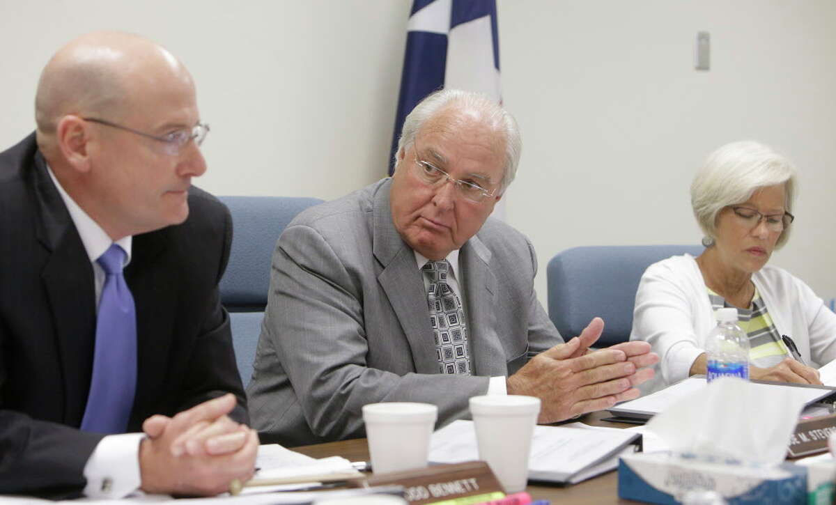 Todd Bennett, left, Joe M. Stevens, Jr., and Suzanne McPherson, right, of the civil service commission are shown during the case regarding Craig Clopton, a former HCSO homicide Sgt. who was fired last year for having sexual contact with a witness in the fatal shooting of Deputy Darren Goforth, shown Thursday, July 21, 2016, in Houston. The commission upheld the sheriff's decision to terminate his employment.