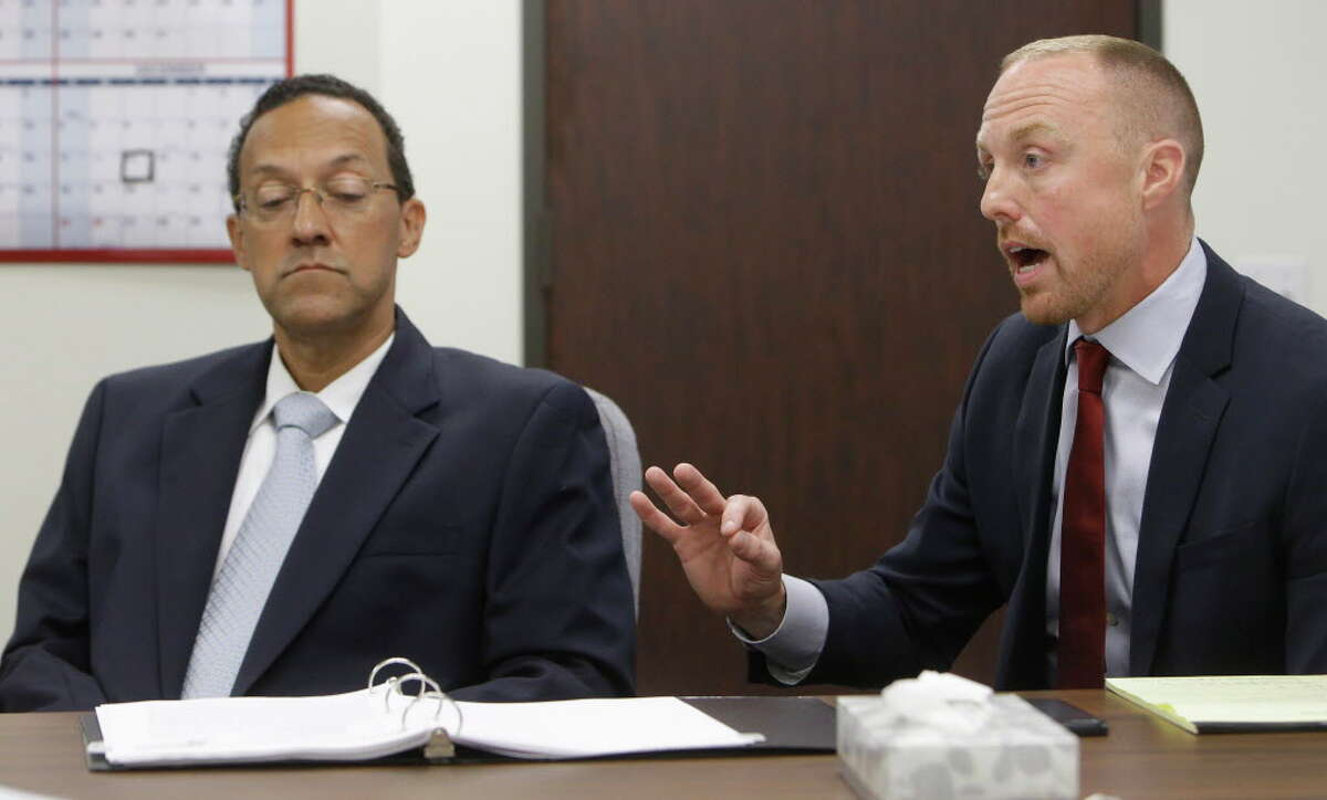Craig Clopton, left, a former HCSO homicide Sgt. who was fired last year for having sexual contact with a witness in the fatal shooting of Deputy Darren Goforth, listens as his attorney Carson Joachim, right, speaks during a civil service commission Thursday, July 21, 2016, in Houston. The commission upheld the sheriff's decision to terminate his employment.