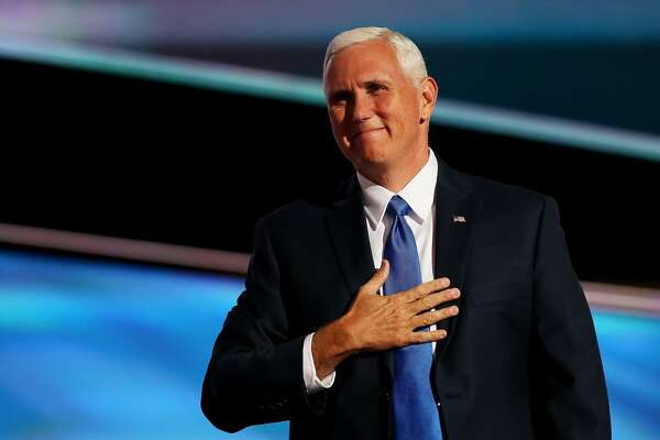 CLEVELAND, OH - JULY 20:  Republican Vice Presidential candidate Mike Pence acknowledges the crowd as he walks on stage to deliver a speech on the third day of the Republican National Convention on July 20, 2016 at the Quicken Loans Arena in Cleveland, Ohio. Republican presidential candidate Donald Trump received the number of votes needed to secure the party's nomination. An estimated 50,000 people are expected in Cleveland, including hundreds of protesters and members of the media. The four-day Republican National Convention kicked off on July 18.  (Photo by John Moore/Getty Images)