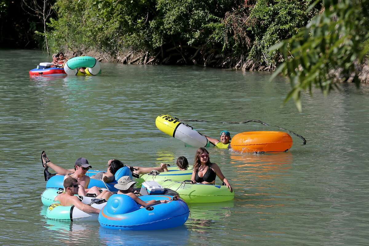 Tubers float the San Marcos River.