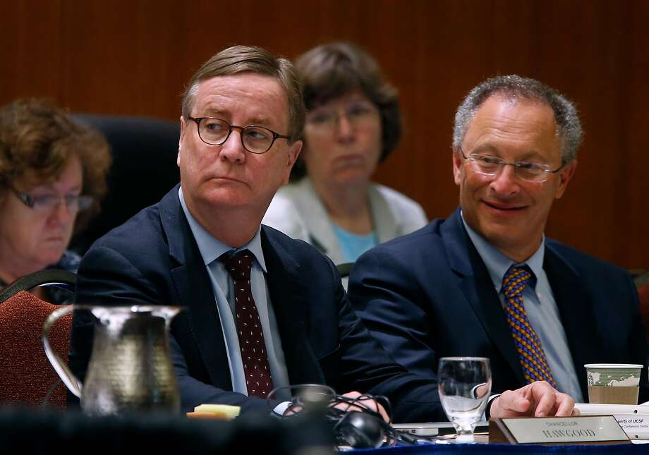 UCSF chancellor Sam Hawgood (left) and UC Davis acting chancellor Ralph Hexter attend a meeting of the University of California Board of Regents to consider an amendment of a policy on outside professional activities of top university management officials in San Francisco, Calif. on Thursday, July 21, 2016. Photo: Paul Chinn / The Chronicle