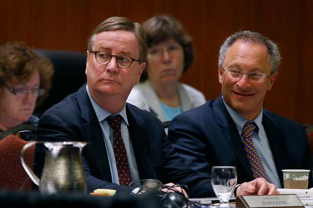 UCSF chancellor Sam Hawgood (left) and UC Davis acting chancellor Ralph Hexter attend a meeting of the University of California Board of Regents to consider an amendment of a policy on outside professional activities of top university management officials in San Francisco, Calif. on Thursday, July 21, 2016.