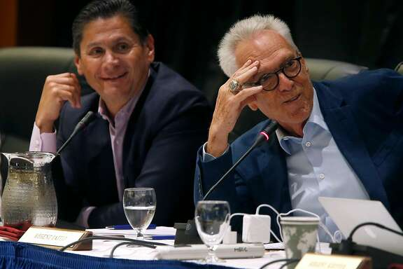 Norman Pattiz (right) comments on an amendment of a policy on outside professional activities of top university management officials at a meeting of the University of California Board of Regents in San Francisco, Calif. on Thursday, July 21, 2016. At left is regent Eloy Ortiz Oakley, recently named the chancellor of California community colleges.