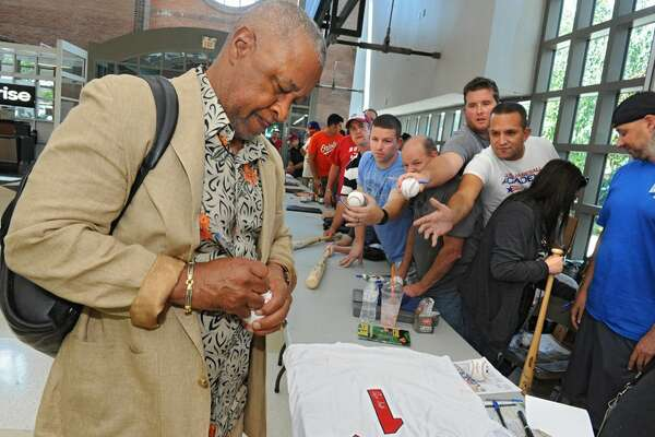 Baseball Hall of Famer Ozzie Smith signs autographs Thursday at Albany International Airport. (Lori Van Buren / Times Union)