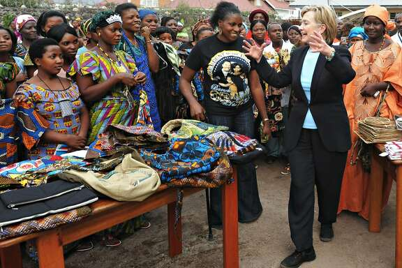 US Secretary of State Hillary Rodham Clinton,  jokes with patients and staff of the Heal Africa clinic in Goma, Congo Tuesday Aug. 11, 2009. (AP Photo/Roberto Schmidt, Pool)