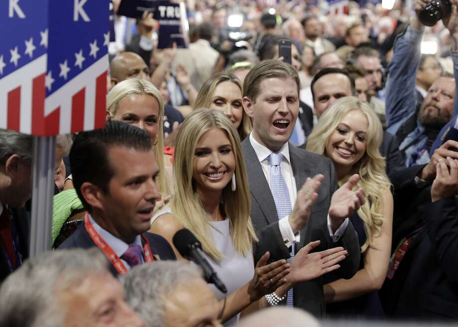 Donald Trump's children — Donald Jr. (left), Ivanka, Eric and Tiffany — celebrate on Cleveland's convention floor Tuesday. Photo: Carolyn Kaster, Associated Press