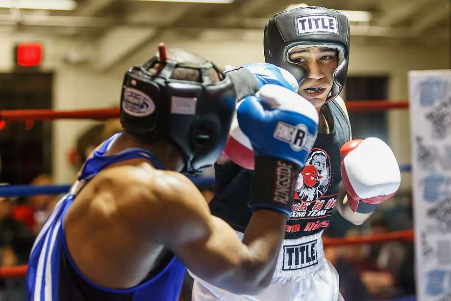 Daniel Baiz looks for an opening in James Beck's defense during their open welterweight bout on opening night of the 2013 San Antonio Regional Golden Gloves tournament at Woodlawn Gym on Feb. 19, 2013. Photo: Marvin Pfeiffer /San Antonio Express-News / Express-News 2013