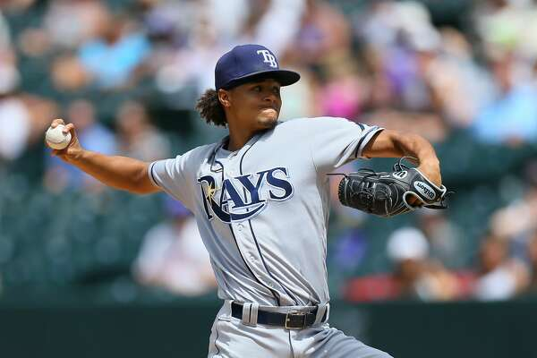DENVER, CO - JULY 20:  Starting pitcher Chris Archer #22 of the Tampa Bay Rays delivers to home plate during the third inning against the Colorado Rockies at Coors Field on July 20, 2016 in Denver, Colorado. (Photo by Justin Edmonds/Getty Images)