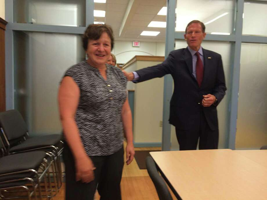 U.S. Sen. Richard Blumenthal congratulates Derby Mayor Anita Dugatto for her efforts in lead paint remediation in the city. Photo: / Michael P. Mayko
