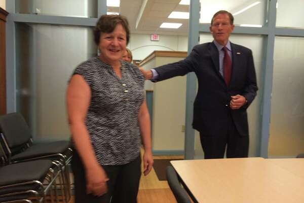 U.S. Sen. Richard Blumenthal congratulates Derby Mayor Anita Dugatto for her efforts in lead paint remediation in the city.