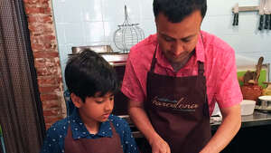 Software engineer Abhishek Parmar and his 9-year-old son, Arjun, making Catalonia-style tomato bread in a cooking class in Barcelona, Spain.