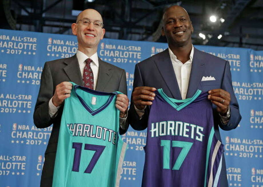 """FILE - In this June 23, 2015, file photo, NBA commissioner Adam Silver, left, and Charlotte Hornets owner Michael Jordan, right, pose for a photo during a news conference to announce Charlotte, N.C., as the site of the 2017 NBA All-Star basketball game. Silver said Thursday, April 21, 2016,  he believes the league has made it """"crystal clear"""" that a change in a North Carolina law that limits anti-discrimination protections for lesbian, gay and transgender people is necessary to stage the 2017 All-Star Game in Charlotte, though is resisting setting a deadline for a decision.  (AP Photo/Chuck Burton, File) Photo: Chuck Burton/Associated Press"""