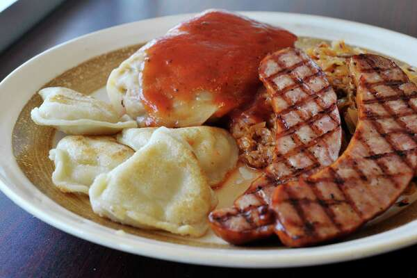 A view of a plate of potato and cheese pierogis, golobki (stuffed cabbage), grilling Polish kielbasa and bigos (sauerkraut stew) at Euro Deli on Thursday, May 28, 2015, in Latham, N.Y.     (Paul Buckowski / Times Union)
