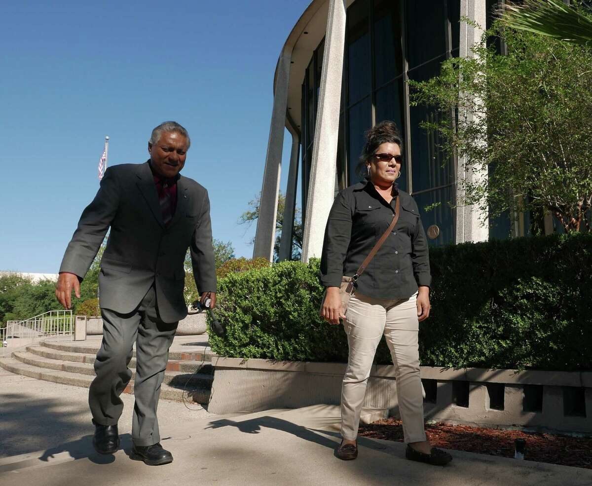 Linda Ann Perez, 47, a former clerk with the Texas Department of Public Safety, leaves the federal courthouse with her attorney, Luis Vera, on Tuesday, November 3, 2015. She pleaded guilty to use of interstate facility in aid of illegal activity for issuing at least 144 fraudulent driver's licenses to undocumented immigrants.