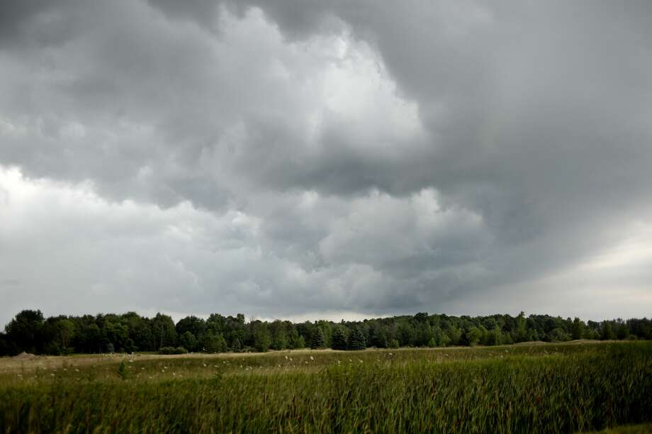 Storm clouds move across fields in Larkin Township on Thursday afternoon. The National Weather Service issued a severe thunderstorm watch for Midland, Bay, Saginaw and 46 other counties across the state. The watch is in effect until 5 p.m. tonight. ThereÕs also a heat advisory for the area in effect until 10 p.m. Friday. Meteorologists say heat continuing into the weekend could prompt an extension of the heat advisory. Photo: Brittney Lohmiller/Midland Daily News