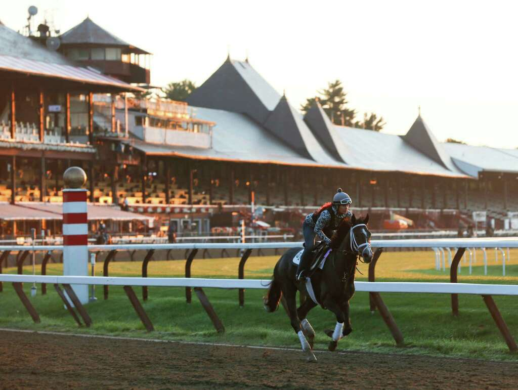 An Exercise Rider Rides A Horse During Morning Workouts At Saratoga Race Course On Thursday