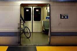 A biker boards a BART train at Balboa Park Station in San Francisco, California, on Thursday, July 21, 2016.