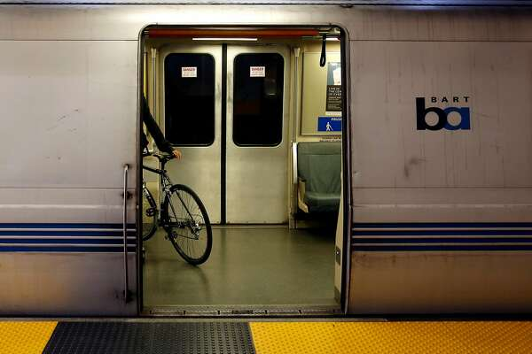 A biker boards a BART train at Balboa Park Station in San Francisco, California, on Thursday, July 21, 2016.