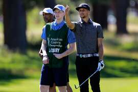 Caddie Bryant Barr and Golden State Warriors' Stephen Curry talk things over during the 2016 American Century Celebrity-Amateur Tournament  in Lake Tahoe, Nevada, California, on Thurs. July 22, 2016. His caddie Bryant Barr, (right) was his roommate back in their college days at Davidson.