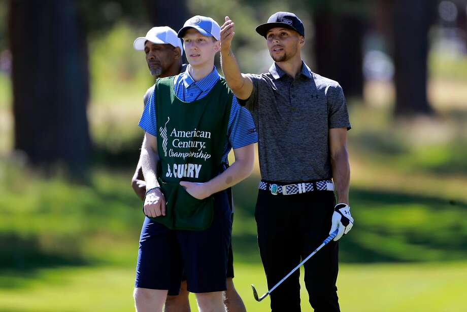 Caddie Bryant Barr and Golden State Warriors' Stephen Curry talk things over during the 2016 American Century Celebrity-Amateur Tournament  in Lake Tahoe, Nevada, California, on Thurs. July 22, 2016. His caddie Bryant Barr, (right) was his roommate back in their college days at Davidson. Photo: Michael Macor, The Chronicle