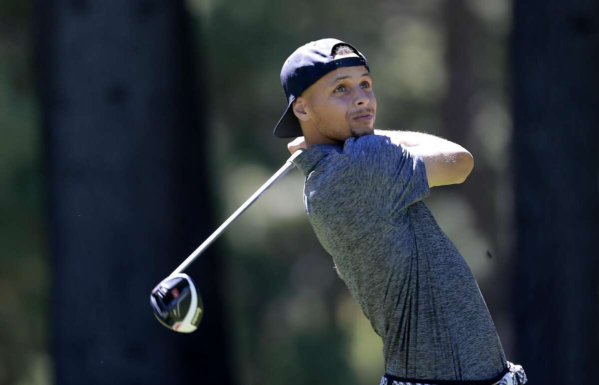 Golden State Warriors' Stephen Curry watches his tee shot on the 13th hole during the 2016 American Century Celebrity-Amateur Tournament in Lake Tahoe, Nevada, California, on Thurs. July 22, 2016. Read the full story