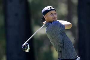 Golden State Warriors' Stephen Curry watches his tee shot on the 13th hole during the 2016 American Century Celebrity-Amateur Tournament  in Lake Tahoe, Nevada, California, on Thurs. July 22, 2016.