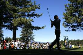Golden State Warriors' Stephen Curry watches his tee shot to the par-3 the 12th tee during the 2016 American Century Celebrity-Amateur Tournament in Lake Tahoe, Nevada, California, on Thurs. July 22, 2016.