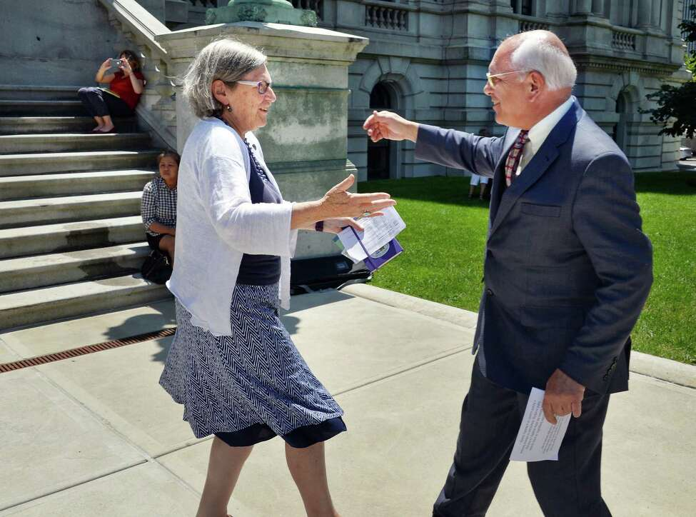Sister Simone Campbell,left, SSS, executive director of NETWORK Lobby for Catholic Social Justice greets Congressman Paul Tonko during a Nuns on the Bus Rally to Mend the Gaps outside the Capitol Thursday July 21, 2016 in Albany, NY. (John Carl D'Annibale / Times Union)