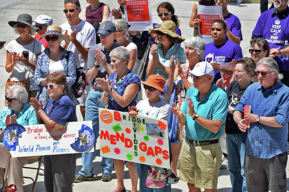 A small group gathers for a Nuns on the Bus Rally to Mend the Gaps outside the Capitol Thursday July 21, 2016 in Albany, NY. (John Carl D'Annibale / Times Union)