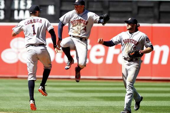 The Houston Astros' Carlos Correa (1) celebrates with teammates George Springer (4), and Jake Marshnick (6) after a 7-0 win against the Oakland Athletics on July 20, 2016, at the Coliseum in Oakland, Calif. The Astros won, 7-0.