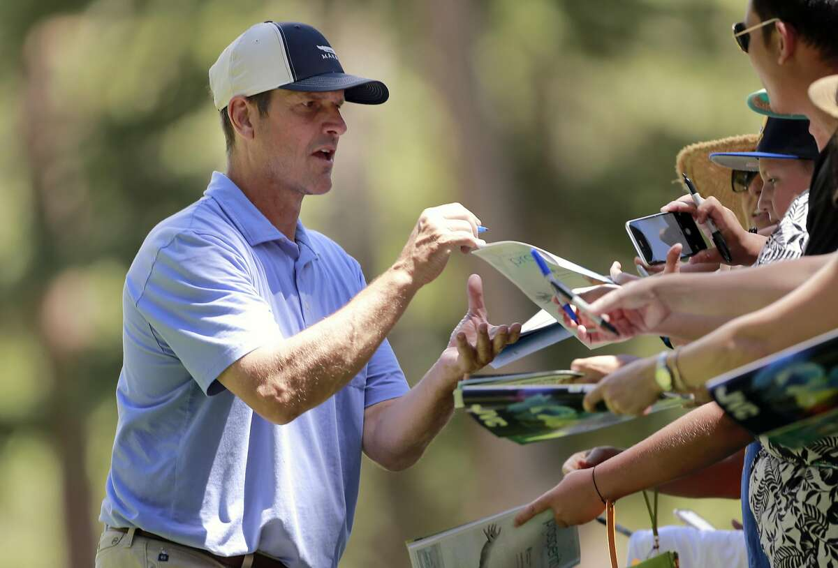 University of Michigan head coach Jim Harbaugh signs autographs on the 7th green during the 2016 American Century Celebrity-Amateur Tournament in Lake Tahoe, Nevada, California, on Thurs. July 22, 2016.