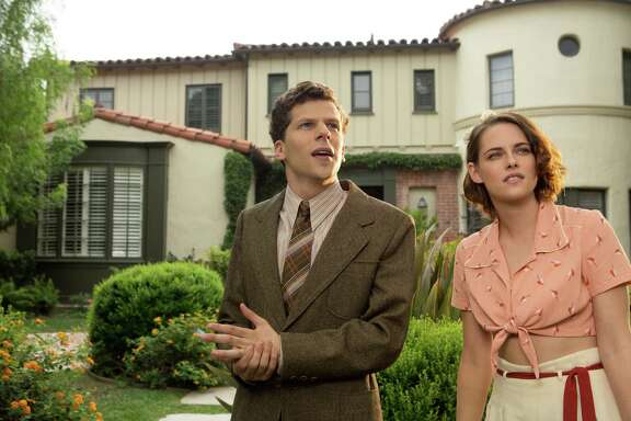 "In this image released by Lionsgate, Jesse Eisenberg, left, and Kristen Stewart appear in a scene from ""Cafe Society."" (Sabrina Lantos/Lionsgate via AP)"