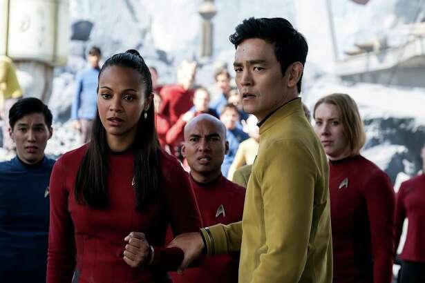 "Zoe Saldana, co-stars as Uhura opposite John Cho as Sulu in ""Star Trek Beyond."""