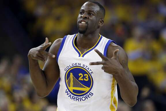 FILE - In this April 27, 2016, file photo, Golden State Warriors' Draymond Green celebrates after scoring against the Houston Rockets during the first half in Game 5 of a first-round NBA basketball playoff series, in Oakland, Calif.  A court conference is scheduled for Golden State Warriors star Draymond Green in his misdemeanor assault and battery case before he leaves next month for the Olympics. The former Michigan State basketball player is accused of striking former Spartans football player Jermaine Edmondson in the jaw during a weekend confrontation near the East Lansing campus. (AP Photo/Marcio Jose Sanchez, File)
