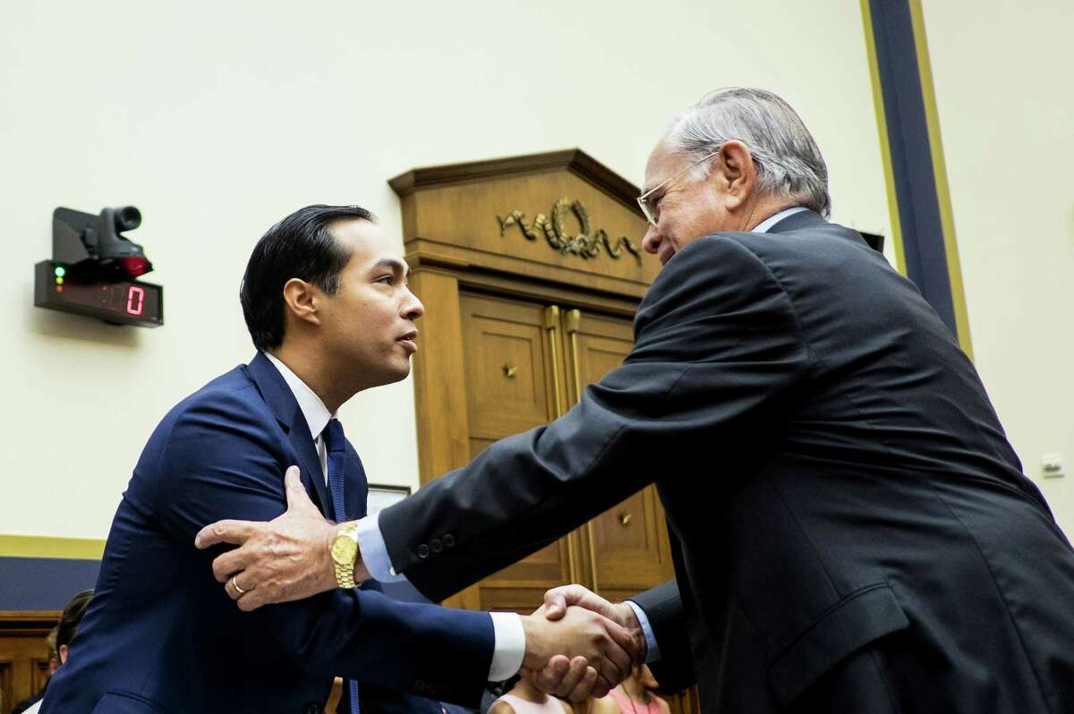 Julian Castro, secretary of U.S. Housing and Urban Development (HUD), left, shakes hands with Representative Ruben Hinojosa, a Democrat from Texas, before the Financial Services Committee hearing in Washington. D.C., U.S., on Wednesday, July 13, 2016. Distressed Asset Stabilization Program recoveries were 16% higher than recoveries on assets conveyed through traditional foreclosure action in last fiscal year, Castro said. Photographer: Pete Marovich/Bloomberg