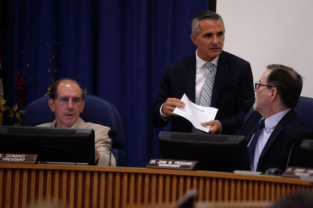 Managers Joe Domino, left, and Lenny Caballero, center, talk with superintendent John Frossard at the Beaumont ISD board meeting on Thursday afternoon. The board managers have decided to step down in May 2017.  Photo taken Thursday 7/21/16 Ryan Pelham/The Enterprise