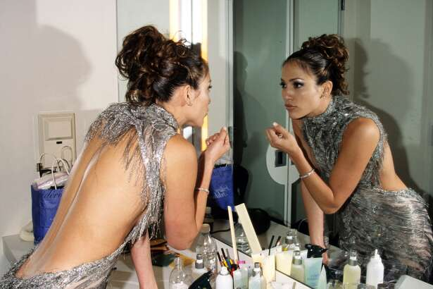 Jennifer Lopez getting ready for the 1998 VH1 Fashion Awards (Photo by Kevin Mazur Archive/WireImage)