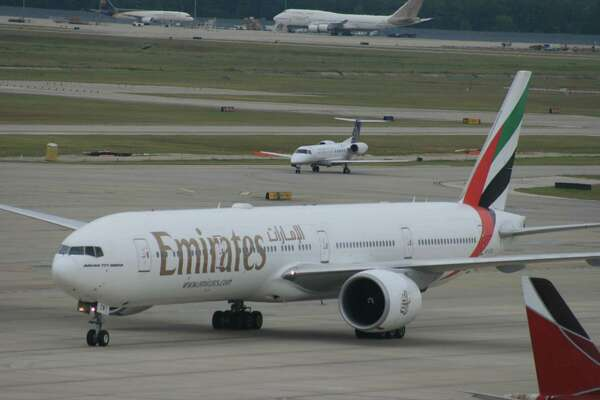 Bill Montgomery  /  Houston Chronicle An Emirates Boeing 777 taxis at Bush Intercontinental Airport in August 2014.