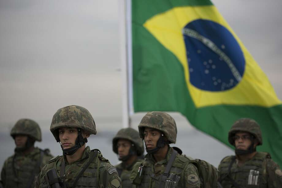 Brazilian marines stand in formation during a training drill simulating a terrorist attack on a ferryboat, ahead of the Olympics in Rio de Janeiro, Brazil, Thursday, July 21, 2016. Photo: Leo Correa, Associated Press